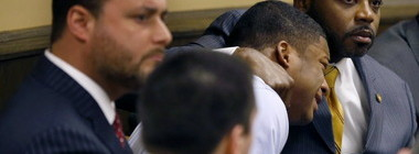 Mal'ik Richmond crying on his lawyer's shoulder in court. Photo By AP