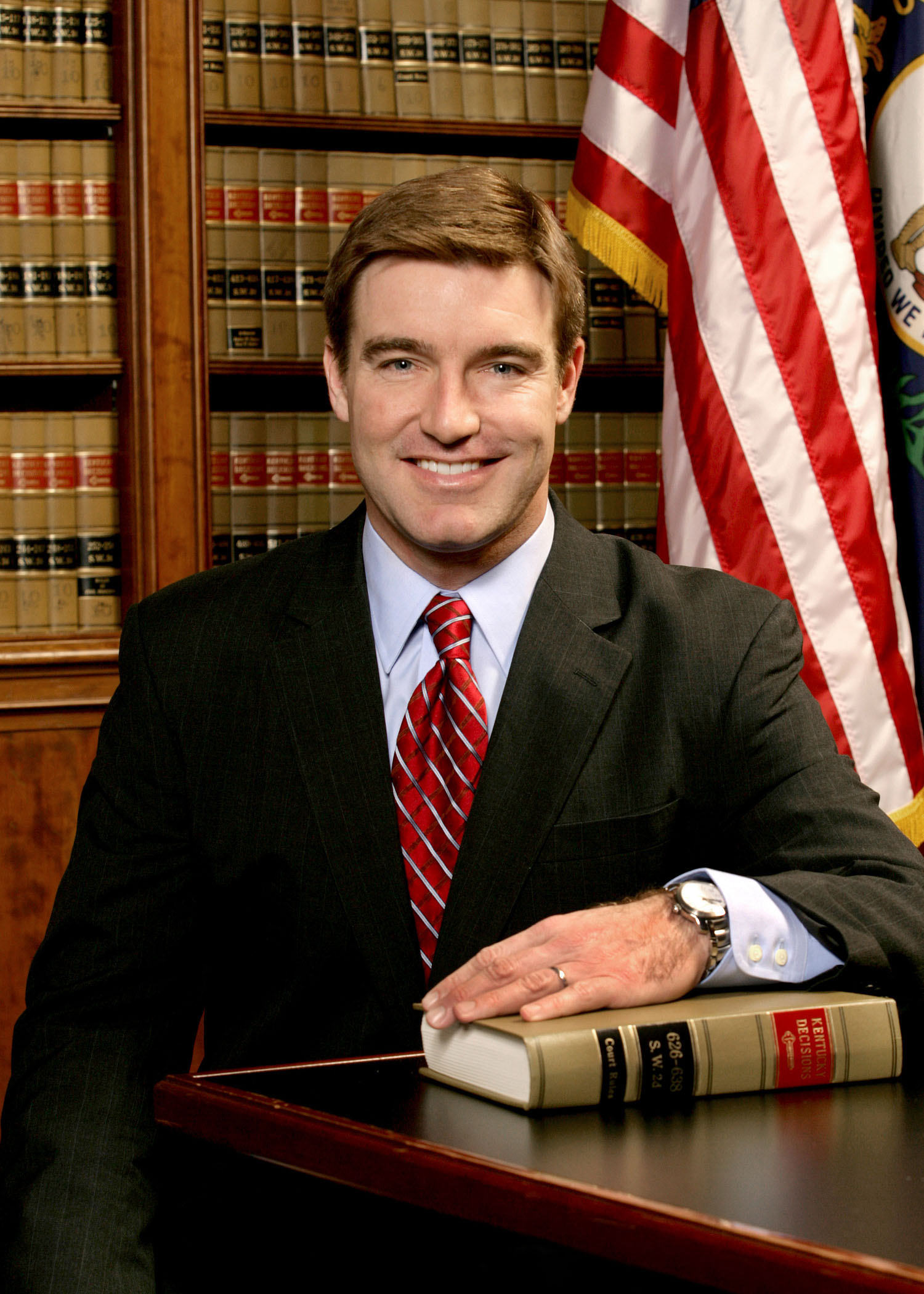 Attorney - US flag and bookshelf full of legal books in the background